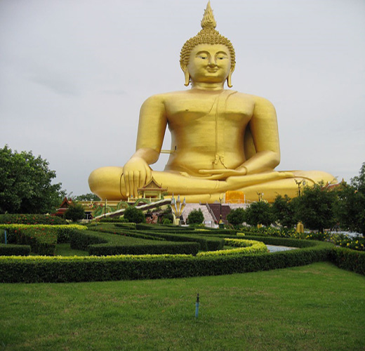Located in the Wat Muang Monastery in Ang Thong province, this statue stands 92 m high, and is 63 m wide. Construction commenced in 1990, and was completed in 2008. It is painted gold and made of concrete. Notice the flames coming up from the pineal gland (7th chakra) as a symbol for the complete control of Kundalini flowing up and down through the spinal cord